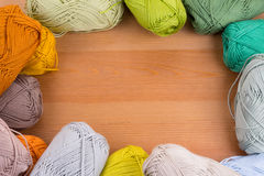 Colorful yarn balls. In wood table background Stock Photo