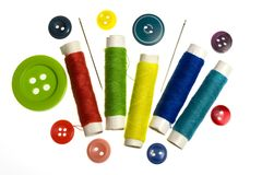 Colorful yarn and buttons. On a white background Royalty Free Stock Image