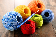 Colorful yarn for crocheting and hook on wooden table Stock Photography