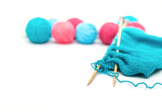 Colorful yarn, knitted fabric and knitting spokes Royalty Free Stock Photography