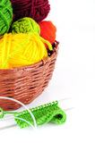 Colorful yarn and needles for knitting. In wicker basket Stock Image