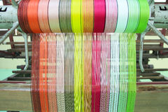 Colorful yarn pattern is set up on the loom bench Royalty Free Stock Images