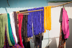 Colorful yarns hang to dry. Dyed colorful yarns hang to dry on a clothesline in a village in indonesia Stock Images