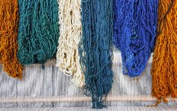 Colorful yarns,blue,green,orange, cream. Colorful yarns traditionally made of wool Royalty Free Stock Photo