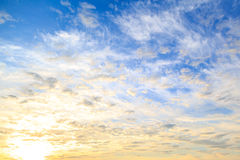 Colorful yellow-blue cloudy sky at sunrise Royalty Free Stock Photos