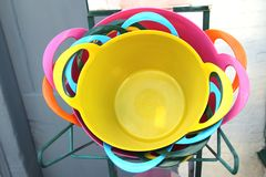 Colorful yellow, blue, orange and pink plastic buckets for sale Royalty Free Stock Image