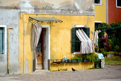 Colorful yellow building corner in Burano, Italy Royalty Free Stock Photos