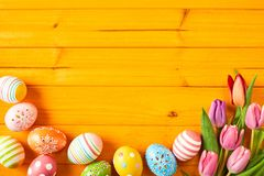Colorful yellow Easter background with copy space Stock Photo