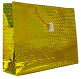 Colorful yellow foil shopping bag Stock Image