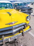 Colorful yellow vintage car in Havana Stock Photography