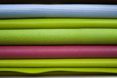 Colorful yoga mats in class. stock photo