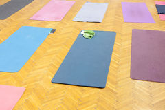 Colorful yoga mats in studio Royalty Free Stock Photos