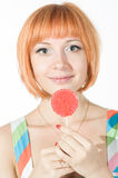 Colorful young woman with lollipop Royalty Free Stock Photography