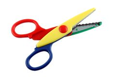 Colorful zigzag scissors. Isolated on pure white royalty free stock photo