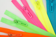 Colorful zippers Stock Images