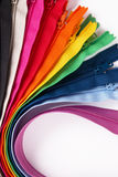 Colorful Zippers in different colors on white background. Royalty Free Stock Photos