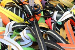 Colorful zippers pile Stock Images
