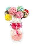 Colorfull与装饰的蛋糕流行音乐在玻璃花瓶洒 库存照片