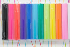 Colorfull彩色塑泥新在包裹 免版税库存照片