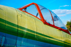 Colorfull airpane parked on the grass at the airfield Royalty Free Stock Image