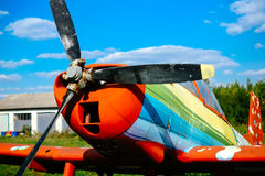Colorfull airpane parked on the grass at the airfield Stock Photo