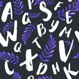 Colorfull alphabet set - pattern of letters on black background with purple leaves. Colorfull alphabet set - pattern of letters on white background Stock Images