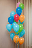 Colorfull balloons in a room. Stylish Birthday, anniversary or other event decorations royalty free stock photography