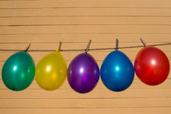 Colorfull balloons on a washing line Stock Photo