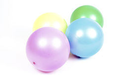 Colorfull Balls. Pink, yellow,blue and green balls on white ground Royalty Free Stock Images