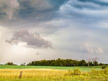 Colorfull Clouds Stormy weather Over Rural Farm Land Royalty Free Stock Image