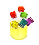 Colorfull dice lollipops. Bounch of colorfull translucent dice shaped lollipops backlit on white background Royalty Free Stock Photos