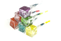 Colorfull dice lollipops. Bounch of colorfull translucent dice shaped lollipops backlit on white background Royalty Free Stock Photo