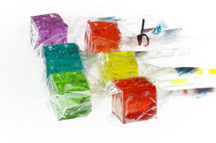 Colorfull dice lollipops. Bounch of colorfull translucent dice shaped lollipops backlit on white background Royalty Free Stock Images