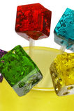 Colorfull dice lollipops. Bounch of colorfull translucent dice shaped lollipops backlit on white background Stock Images