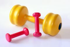 Colorfull dumb bells. Composition of diffrent weight dumb bells Stock Photography