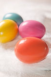 Colorfull Easter eggs on feather background Stock Photography