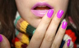 Colorfull girl. Pink girl's lips and nails with colorful scarf Stock Images