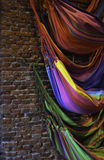 Colorfull hammocks on brick wall Royalty Free Stock Photos