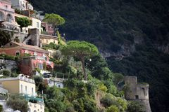 Positano houses on steep hill with tower. Colorfull houses on steep hill with tower at Positano, Italy royalty free stock image