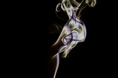 Colorfull isolated incense smoke art Royalty Free Stock Photo
