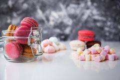 Colorful macaroons with marshmallows royalty free stock images
