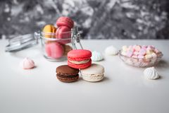 Colorful macaroons with marshmallows royalty free stock photography