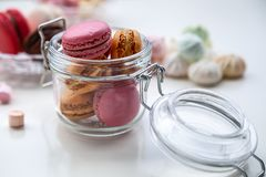 Colorful macaroons with marshmallows stock photography