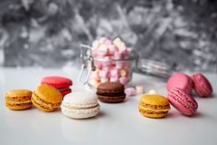 Colorful macaroons with marshmallows royalty free stock photos