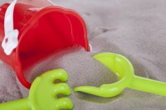 Colorfull miniature toys in sand on beach Royalty Free Stock Image