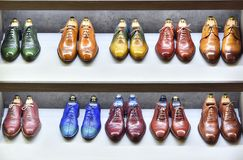 Colorfull pairs of shoes are exposed for sale. royalty free stock image