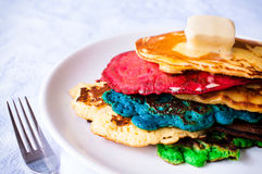 Colorfull pancake. Colorfull homemade pancakes with melted butter on the top Royalty Free Stock Photo