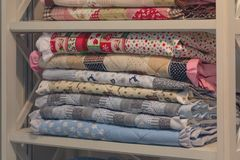Colorfull plaids, blankets on shelves in store Stock Images