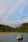 Colorfull rainbow over a tropical beach Royalty Free Stock Images