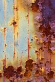 Colorfull and rusty. Rusty iron plate with color drop off Royalty Free Stock Photo